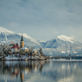 by Mario Horvat - City,  Street & Park  Vistas ( water, reflection, mountains, winter, church, snow, bled, lake, city )