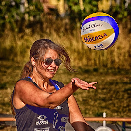 Isabelle's Service by Marco Bertamé - Sports & Fitness Other Sports ( hand, sun glasses, ball, woman, beach volley, action, service, lady, summer, smile )