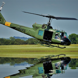 getting across by Benito Flores Jr - Transportation Helicopters