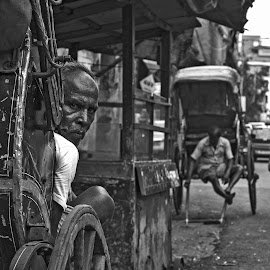 The Rickshaw Puller by Ritwik Ray - City,  Street & Park  Street Scenes ( streetscape, portraits, street photo, street scenes, street photography )