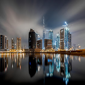Time Travel by Wissam Chehade - Buildings & Architecture Other Exteriors ( clouds, skyline, mydubai, business bay, reflections, cityscape, burj khalifa, lights, sky, towers, dubai, uae, night, long exposure )
