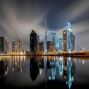 Time Travel by Wissam Chehade - Buildings & Architecture Other Exteriors ( clouds, skyline, mydubai, business bay, reflections, cityscape, burj khalifa, lights, sky, towers, dubai, uae, night, long exposure,  )