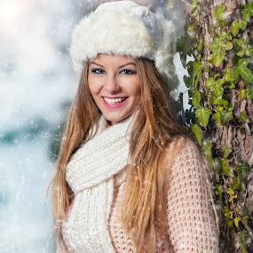 pretty young woman in a winter fashion shot by Iancu Cristi - People Portraits of Women ( seasonal, makeup, fairy, snowflake, feather, caucasian, sexy, cold, flake, woman, lifestyle, snow, glamorous, eye, cool, wild, xmas, forest, happiness, portrait, holiday, december, winter, eyelash, face, one woman only, model, fashion, clothing, joy, beauty, cute, pretty, glamor, fantasy, girl, attractive, happy, grey, beautiful, christmas, expressing positivity, gloves, adult, young, princess, female, blue, elegant )