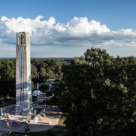 NC State Bell Tower by Thomas Shaw - Buildings & Architecture Statues & Monuments ( clouds, university, flags, memorial, green, white, college, bell tower, gray, people, north carolina state university, world war 2, tower, sky, blue, north carolina state, trees, campus )