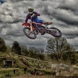 Acrobatic 53 by Marco Bertamé - Sports & Fitness Motorsports ( clouds, speed, number, yellow, race, acrobatic, noise, jump, flying, red, motocross, blue, dust, 53, grey, air, high )