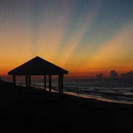 Sun rays beaming over horizon by Mark Perkins - Landscapes Sunsets & Sunrises ( surf city, sunrise, beach, gazebo )
