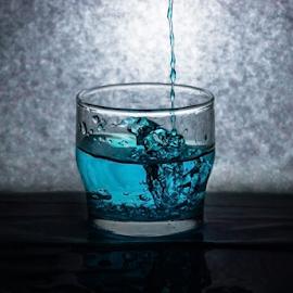 Blue splash by Suzana Trifkovic - Food & Drink Alcohol & Drinks ( splash, blue, back lit, drink, glass )