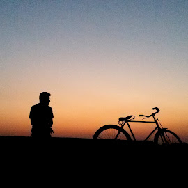 The cycle and the Cyclist  by Shubhashish Chakrabartty - Transportation Bicycles ( cycle, silhouette, transportation )