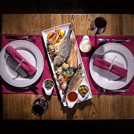 Dinner is seerved by Zarko Piljak - Food & Drink Eating ( dinner, shrimp, fish, sea food, vegetables, romantic, couple, table )