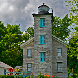 Old Sodus Light by Rick King - Buildings & Architecture Public & Historical ( clouds, building, light house, lighthouse, stone, historical, historic )