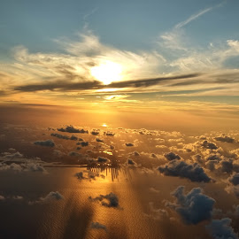 Sunset over the clouds by Darshan Gabani - Landscapes Sunsets & Sunrises ( miami, flight, ocean, ocean view, sunset, airplane, clouds, skyline )