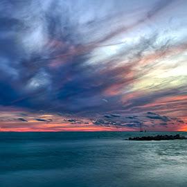 Sunset by Bill Frische - Landscapes Sunsets & Sunrises ( water, rise, set, sunset, cloud, ocean, rock, sunrise, boat, sun )