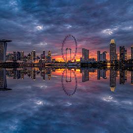 by Gordon Koh - City,  Street & Park  Skylines ( clouds, shenton way, skyline, blue hour, twilight, riverfront, suntec city, cityscape, travel, singapore, city, skyscraper, financial district, sunset, jubliee bridge, buildings, asia, singapore flyer, long exposure, waterfront,  )
