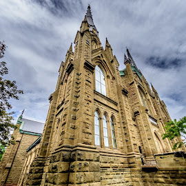 church by Vernie Gillespie - Buildings & Architecture Places of Worship ( clouds, church, grass, stone, close up )