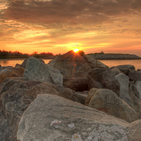 Sunset at the Tip by Rashid Mohamad - Landscapes Beaches ( rocky, sunset, yellow, beach, stones )