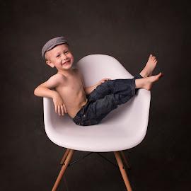 Modern Newspaper Boy by Nicole Ferris - Babies & Children Child Portraits ( child, chair, sitting, jeans, smile, boy, hat,  )