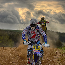 Dust'n Clouds ! by Marco Bertamé - Sports & Fitness Motorsports ( clouds, speed, number, yellow, race, jump, noise, 161, two, red, landing, motocross, blue, dust, clumps, grey, duel )