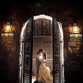 Doorway of Love by Joseph Humphries - Wedding Bride & Groom ( kissing, arch, weddings, wedding, wedding dress, bride and groom, backlighting, rustic )