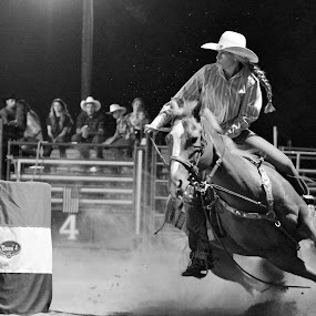 Looking For The Win by Brian  Shoemaker  - Black & White Sports ( barrel racing, barrels, rodeo, cowgirl )