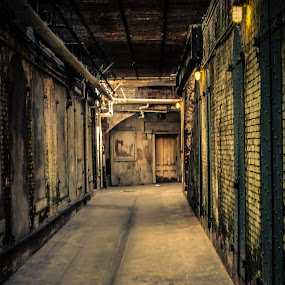Walk The Line by Kevin Pastores - Buildings & Architecture Other Interior ( dim, eerie, cold, dark, solitude, hallway, pipes, jail, dingy, musty, gloomy, Lighting, moods, mood lighting )