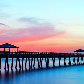 Juno Beach Pier Sunrise by Carl Albro - Buildings & Architecture Bridges & Suspended Structures ( water, dawn, pink sky, pier, sunrise )