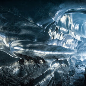 Inside the ice cave by Tim Vollmer - Landscapes Caves & Formations ( water, ice cave, glacier, solheimajökull, iceland, adventure, blue ice, ice, ice tunnel, www.timvollmer.de, light, photography )