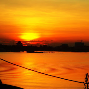 From the lake side hotel by Minami Kojima - Landscapes Sunsets & Sunrises ( orange, shadow, sunset, lake, travel, cambodia )