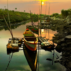 Boats on drydock by Jun Santos - Landscapes Sunsets & Sunrises ( stream, waterscape, sunset, boats, landscape )