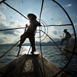 at work by Mike Mulligan - People Street & Candids ( inle lake, fishermen, myanmar, sunset, boats )