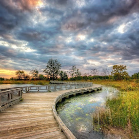 Boardwalk by Kevin Miller - Buildings & Architecture Bridges & Suspended Structures ( water, clouds, sunset, path, marsh, curves, boardwalk )