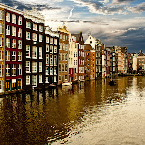 AMSTERDAM by Gianluca Presto - Buildings & Architecture Homes ( water, clouds, home, reflection, houses, skyline, europe, waterscape, architectural detail, historic district, amsterdam, travel, architecture, house, amstel, historic, netherlands, ancient, sky, holland, buildings, cloudy, homes, travel photography,  )