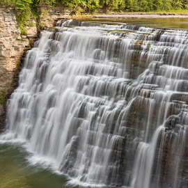 Middle Falls at Letchworth by Kenneth Keifer - Landscapes Waterscapes ( stream, splash, gorge, rocky, waterfall, western new york, stone, rock, falling, blur, flow, landscape, genesee, castile, nature, upstate new york, long exposure, letchworth state park, tall, finger lakes, wild, genesee river, flowing, cliff, canyon, plunging, scenic, new york, plunge, united states, letchworth, blurred, finger lakes region, splashing, cascade, cascading, cataract, ledges, whitewater, river )