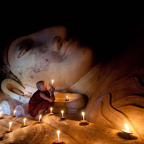 Novice in the Candle Light by Black Mutant - Travel Locations Landmarks ( prayer, myanmar, monk, novice, bagan, worship )