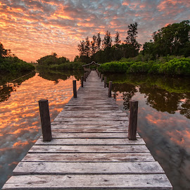 sunrise at lake by Christianto Mogolid - Buildings & Architecture Bridges & Suspended Structures ( cloud, reflection, sunset, jetty, water )