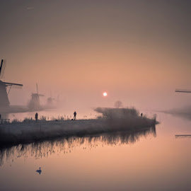 Foggy Sunrise at Kinderdijk by Vojkan Milosev - Landscapes Sunsets & Sunrises ( dawn, winter, fog, kinderdijk, holland, sunrise, windmill, mist, relax, tranquil, relaxing, tranquility )