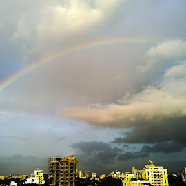 Rainbow in the city by Vikas Kulkarni - Landscapes Cloud Formations
