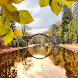 The famous Devils bridge, lokally known as Rakotzbridge or Rakotzbrücke by Robert  Płóciennik - City,  Street & Park  City Parks ( pier, reflection, nature, park, landscape )