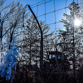 a fence, running hose, tractor and ice by Jason Lockhart - Landscapes Prairies, Meadows & Fields ( wisconsin, fence, ice, trees, tractor, jefferson county, sun, running hose )