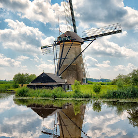 Kinderdyk 1 by Colin Dixon - Landscapes Waterscapes ( clouds, water, mills, kinderdyk, holland, dyks, windmills, sun, pwcreflections-dq )