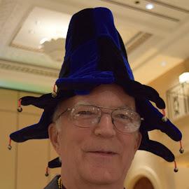 Man in jingle hat by Monique Littlejohn - People Portraits of Men ( costume party, jingle hat, blue hat, fancy dress party, man in hat )