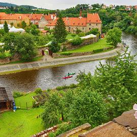 Vltava river at Cesky Krumlovo by Radu Eftimie - Landscapes Waterscapes ( boats, vltava, buildings, bridge )