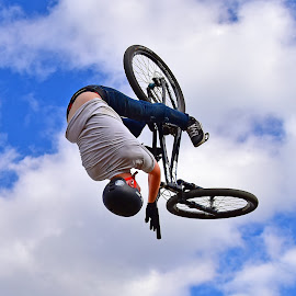 Keen Stunt by Marco Bertamé - Sports & Fitness Other Sports ( clouds, wheel, white, round, dow, stunt, upside down, bicycle, sky, blue, fall, air, grey, high )