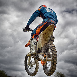 Too Fast ! by Marco Bertamé - Sports & Fitness Motorsports ( clouds, wheel, speed, rear, back, number, race, noise, jump, red, motocross, blue, cloudy, air, grey, high, 88 )