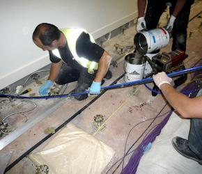 Resin injection sealing floor cracks in void