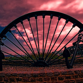 Ironwork at Seaham Sunset by Dee Tee - City,  Street & Park  City Parks ( clouds, sky, wheel, sunset, ground, bricks, iron, anchor,  )