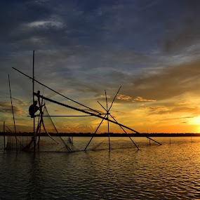 FIFHING AT SUNSET 5 by Dipankar Singha - Landscapes Sunsets & Sunrises