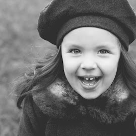 Ready for the Cold by Lindsey Sides - Babies & Children Child Portraits ( contrast, detail, black and white, child portrait, child photography, bundled up, smile, teeth, coat, portrait, emotion )