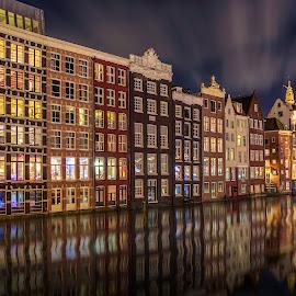 Amterdam Canal Houses Damrak by Michael van der Burg - City,  Street & Park  Street Scenes ( canals, damrak, holland, night, amsterdam, canal, netherlands )