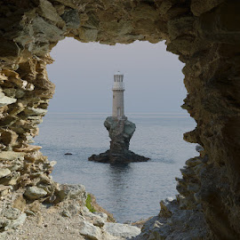 Lighthouse Opening by Bill Peppas - Landscapes Waterscapes ( water, hellas, andros, greece, lighthouse, turlitis, sea, ocean, lake, cyclades, faros, kyklades, tourlitis, light house, mediterranean, castle, peephole, light, pond, hole )