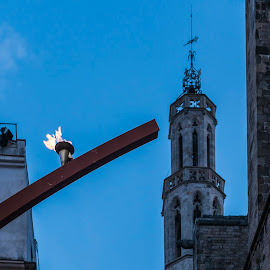 Symbols by Liam Coburn Dunne - City,  Street & Park  Historic Districts ( nikon 24-70, sky, belief, church, blue, nikon d800, barrio gotico, remembrance, flame, eternal )